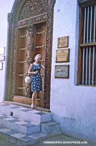 Shannon Moeser in front of Zanzibar door, July 5, 1964.