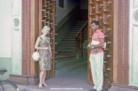 Dick-Dick and Shannon Moeser in front of open door in Zanzibar, July 6, 1964.