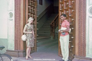 Dick-Dick and Shannon Moeser in front of open door in Zanzibar, July 5, 1964.