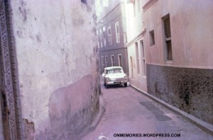 Car in narrow Zanzibar street (this was a two-way street), in July 5, 1964.